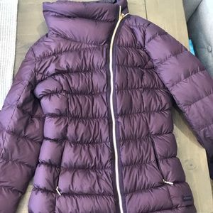 Athlete  puffer jacket with asymmetrical zipper
